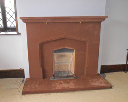 Sandstone fireplace in a traditional design
